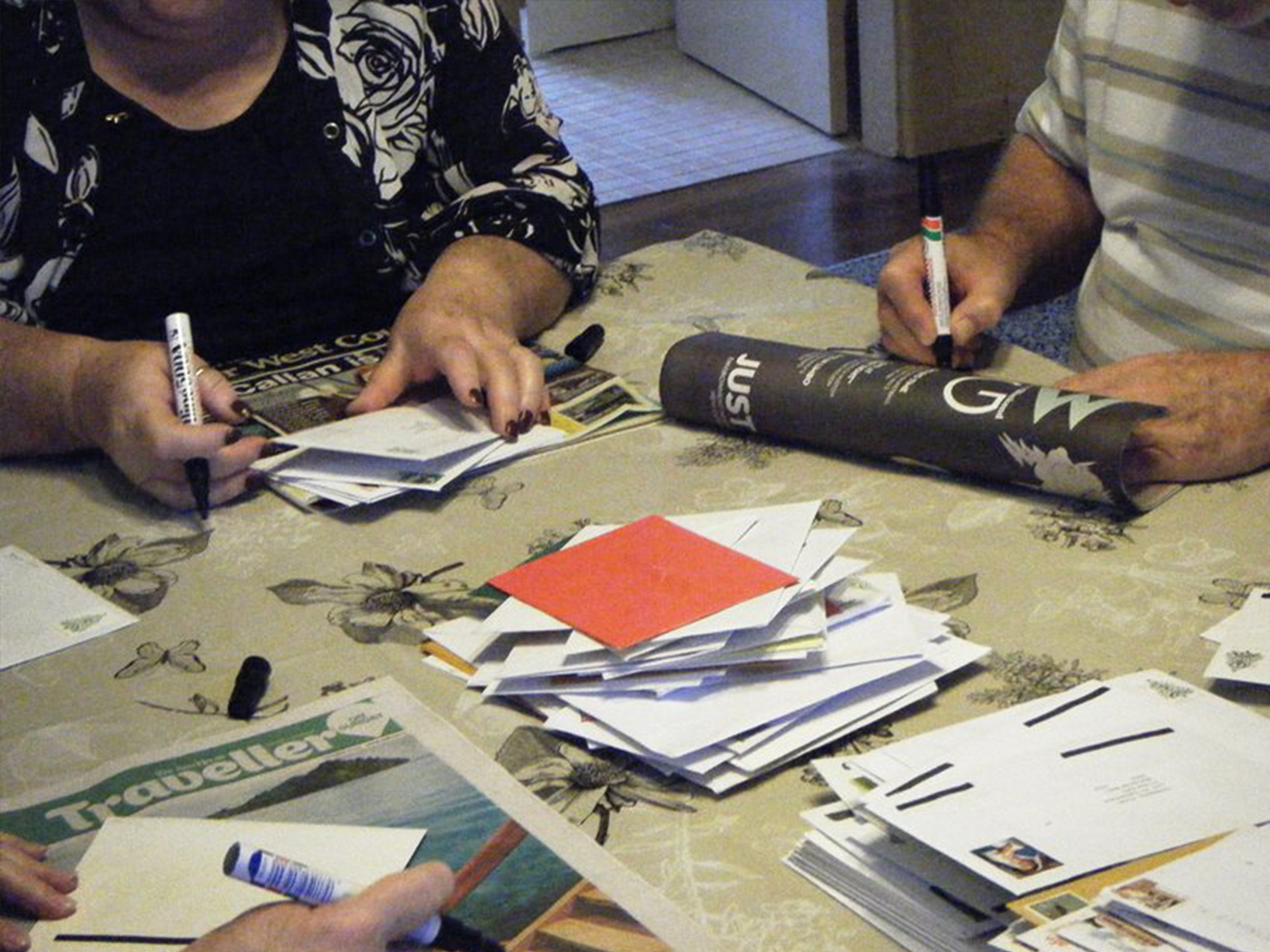 Volunteers re-addressing Christmas cards
