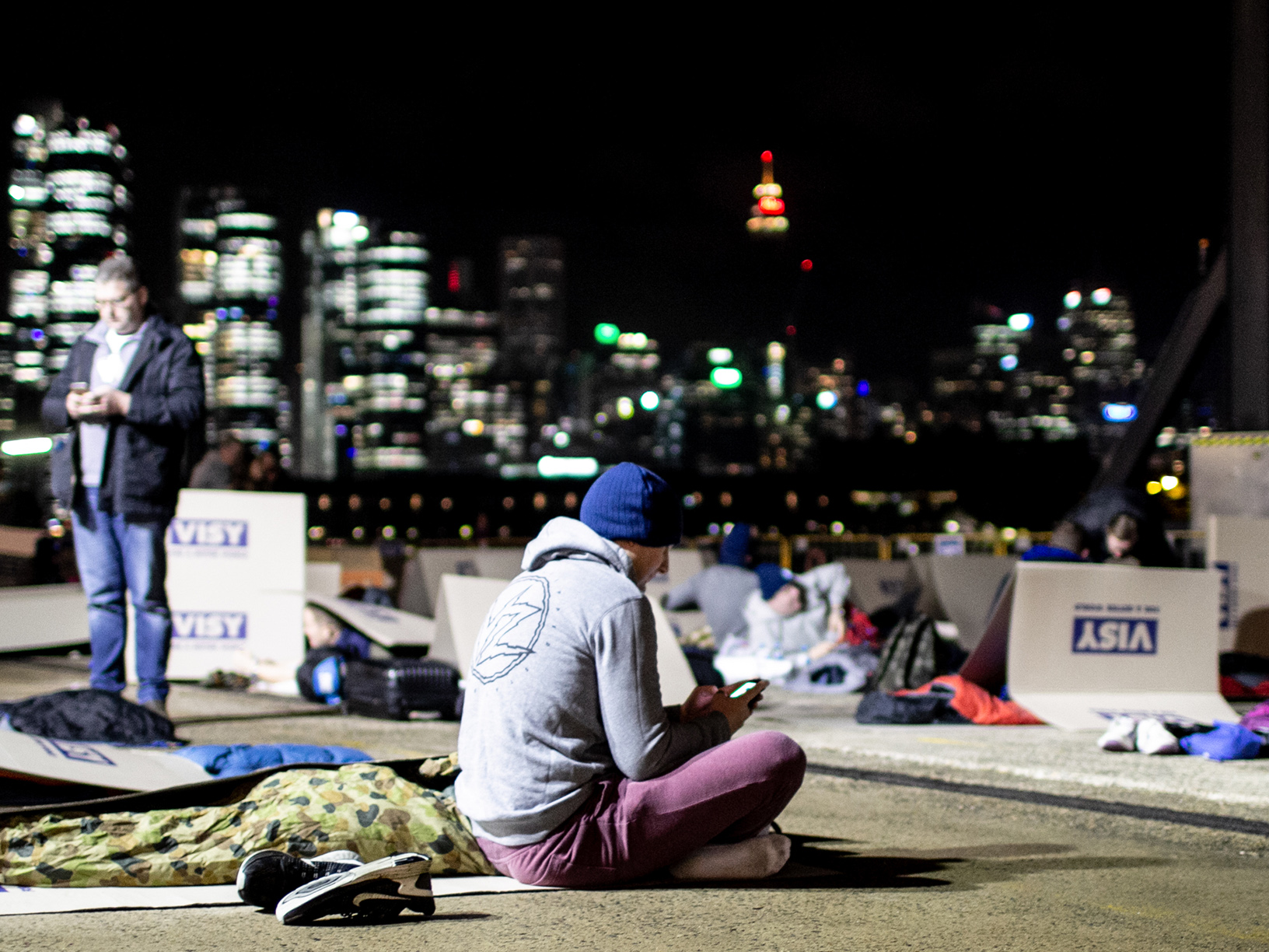 CEOs set up to sleep outside for the night against the Sydney skyline