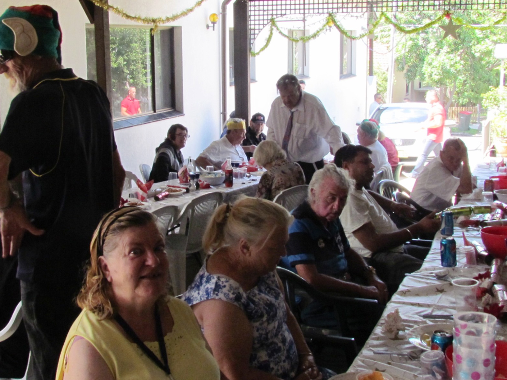 Guests enjoying lunch under the carport at Gethsemane Community
