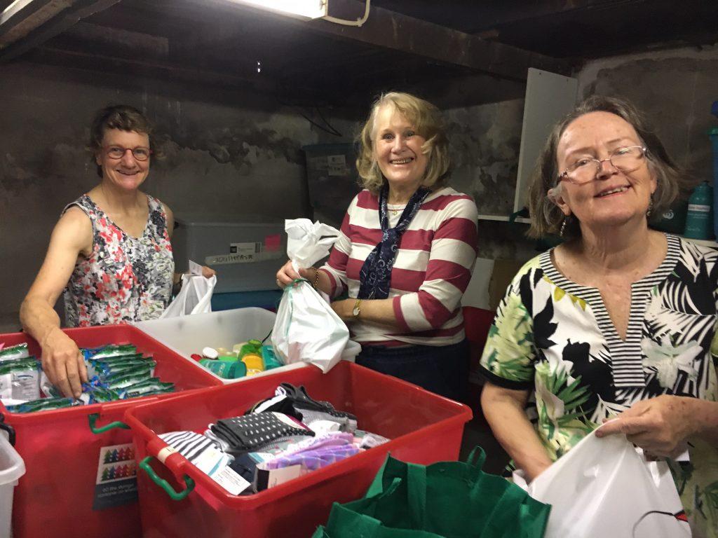 Volunteers help pack Christmas gift hampers at Gethsemane Community Inc