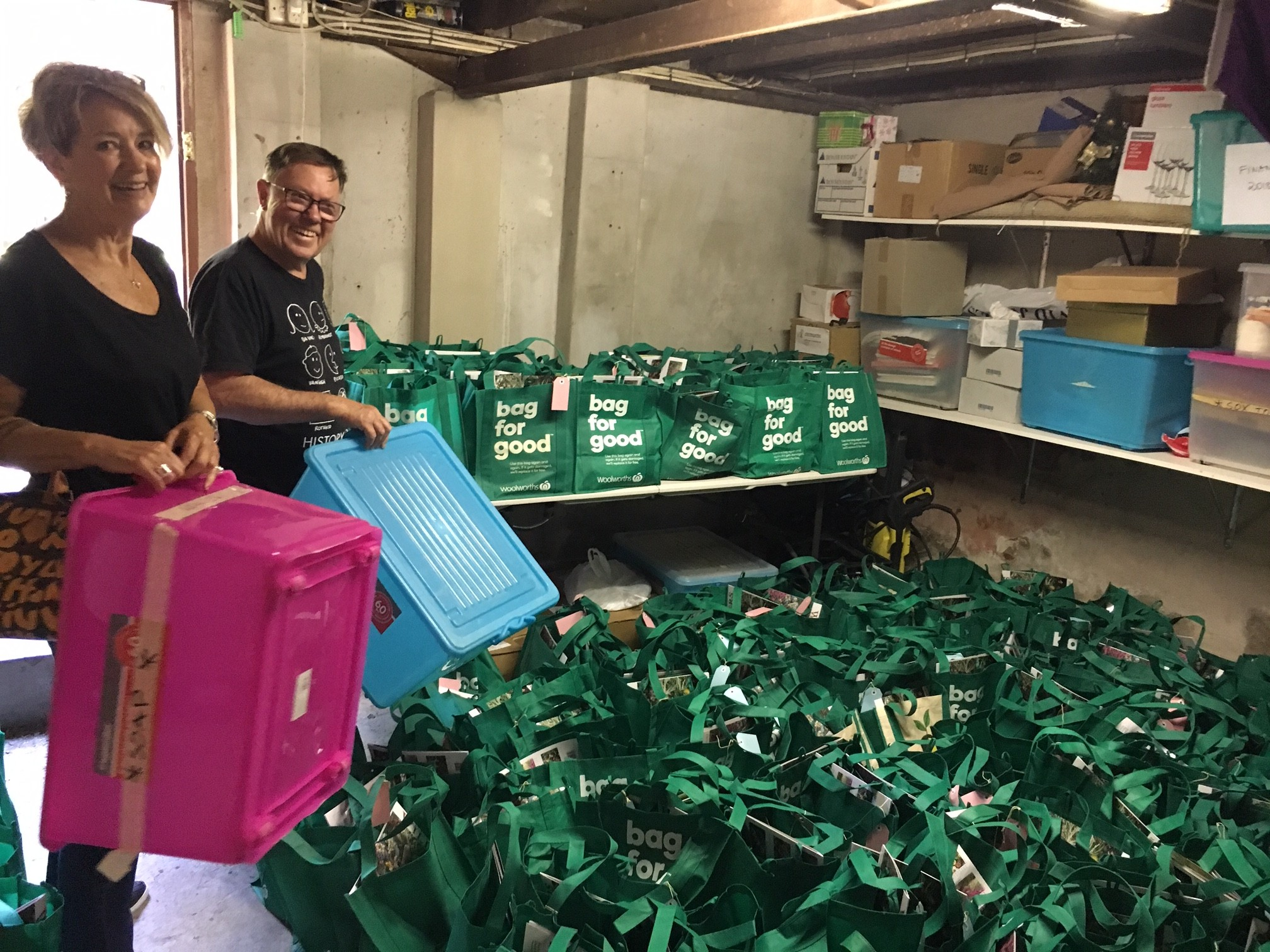 Gethsemane Community volunteers with a collection of Christmas gift hampers for the poor