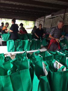 Gethsemane Community volunteers packing gift bags