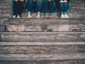 Teenagers sitting on stairs