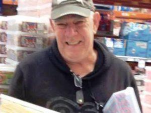 A volunteer at Gethsemane packing gift parcels