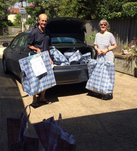volunteers unloading donated gifts from car boot