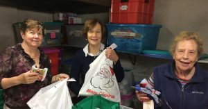 volunteers packing gift parcels